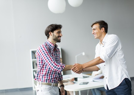 Handshake business: Young people in the office Stock Photo