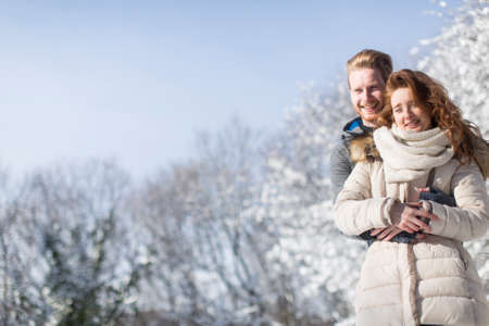 couple winter: Young couple at winter forest Stock Photo