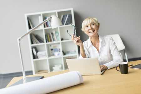 working woman: Woman working in the office Stock Photo