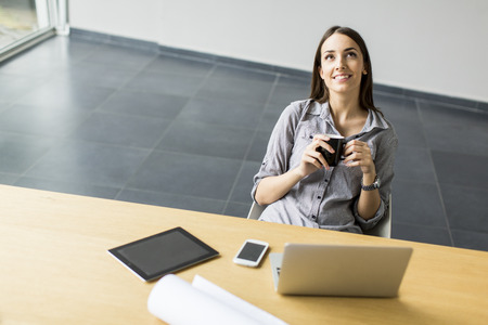 working: Young woman working in the office Stock Photo
