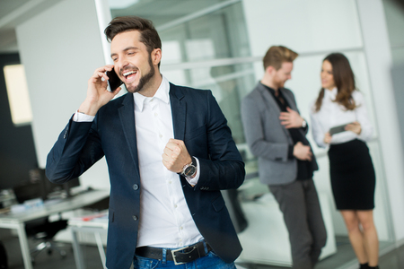 alling: Young people in the office Stock Photo