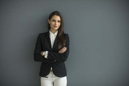 壁の若いビジネス女性 写真素材