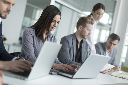 employee: Young people in the office Stock Photo