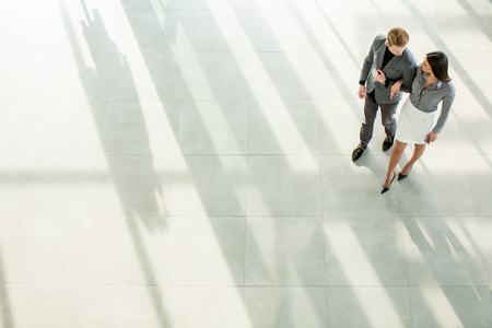 Young man and woman in the office