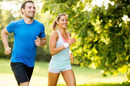 woman running: Young couple running Stock Photo