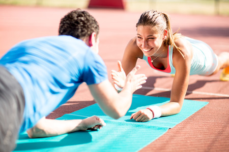 Woman training with personal trainer