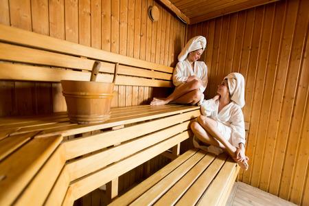 Young women relaxing in the sauna
