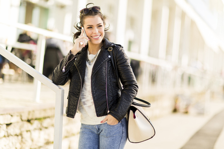 woman at the phone: Young woman with mobile phone