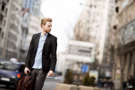 city traffic: Young red hair man outdoors