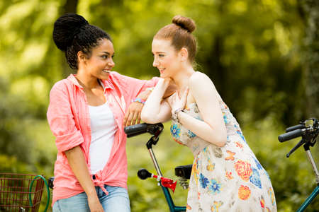 affectionate action: Young women posing by the bicycle
