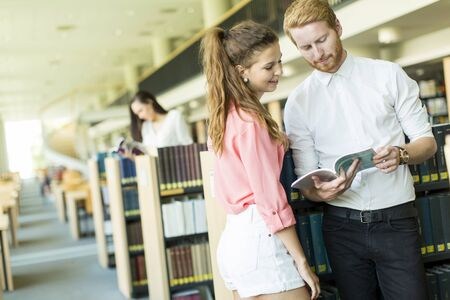 choose university: Young couple in the library