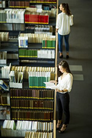 university choice: Young women in the library