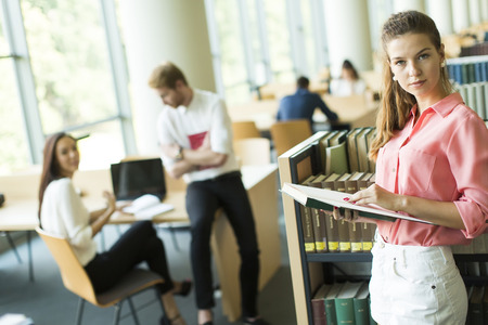 choose university: Young woman in the library