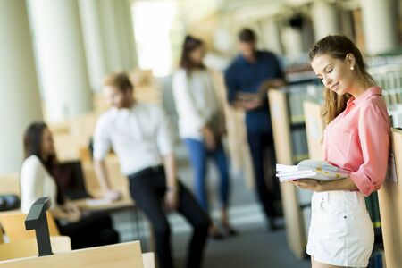 university choice: Young woman in the library