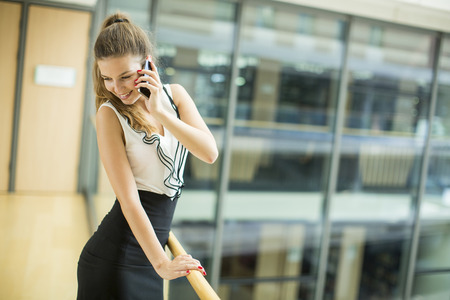businessowman: Young businesswoman with mobile phone Stock Photo
