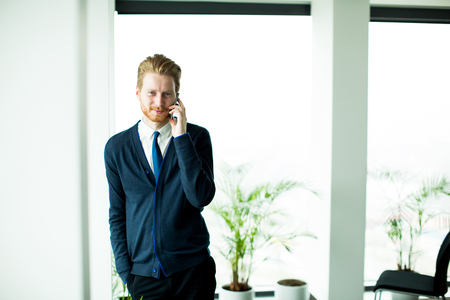 phonecall: Young man working in the office Stock Photo