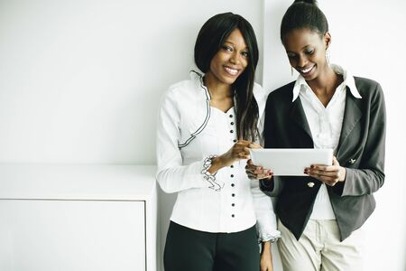 ethnic woman: Young african women with tablet in the office