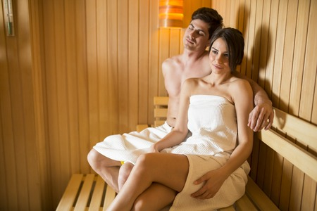 sauna: Young couple relaxing in the sauna Stock Photo