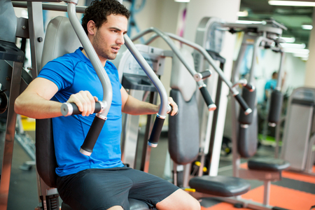 attractive male: Young man training in the gym