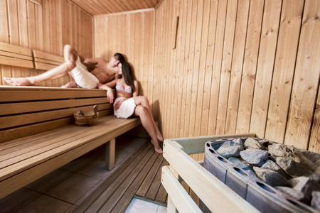 Young couple relaxing in the sauna 스톡 콘텐츠