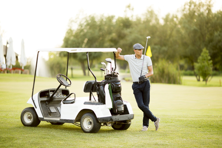 woman golf: Young couple at golf cart Stock Photo