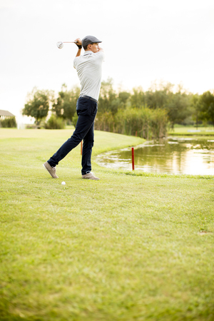 playing golf: Young man playing golf