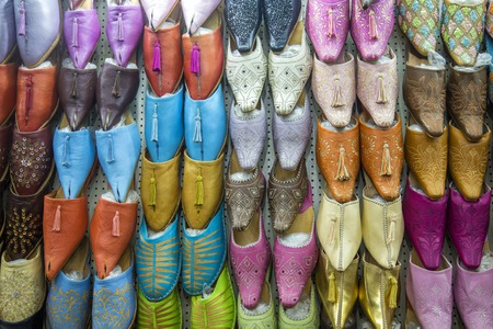 souk: Colorful babiuches at souk in Marrakech, Morocco