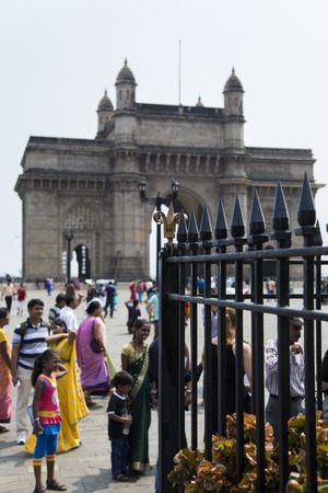 monument in india: MUMBAI, INDIA - OCTOBER 9, 2015: Unidentified people ba Gateway of India in Mumbai. This is a monument built at 1924 by architect George Wittet,
