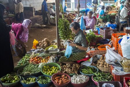 varkala: VARKALA, INDIA - OCTOBER 18, 2015: Unidentified  people on the market buying and selling agricultures products. Kerala produces 97% of the national output of black pepper and 85% of the natural rubber in country.