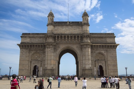 MUMBAI, INDIA - OCTOBER 9, 2015: Unidentified people ba Gateway of India in Mumbai. This is a monument built at 1924 by architect George Wittet,
