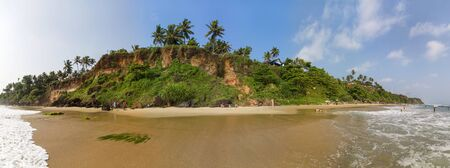 tertiary: VARKALA, INDIA - OCTOBER 17, 2015: Unidentified people at Varkala beach in India. This beach at Arabian sea is famous for tertiary sedimentary formation cliffs. Editorial