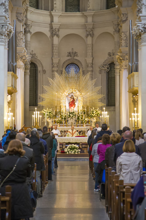 religious service: LECCE, ITALY - APRIL 5, 2015: Unidentified people at Lecce cathedral in Italy. The cathedral was first built in 1144 and was rebuilt in 1659 by the architect Giuseppe Zimbalo.