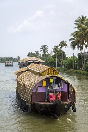 backwaters: KERALA, INDIA - OCTOBER 16, 2015: Boats at backwaters in Kerala, India. The backwaters are an extensive network of 41 west flowing interlocking rivers, lakes and canals that center around Alleppey, Kumarakom and Punnamada. Editorial