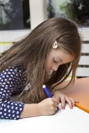 playroom: Little girl drawing at playroom