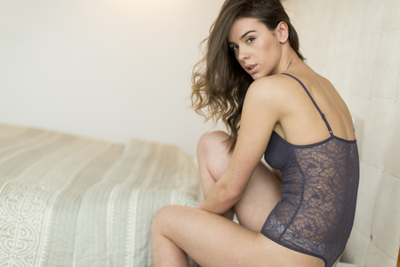 girl bra: Young woman in underwear in the room