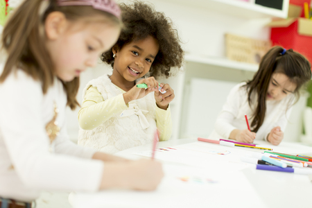 Multiracial children drawing in the playroom 스톡 콘텐츠