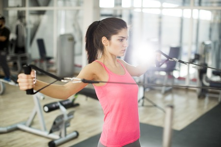 musculature: Young woman in the gym Stock Photo