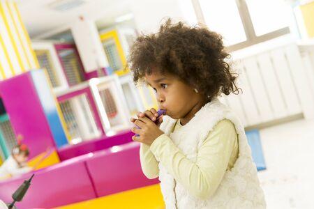 playroom: Multiracial liitle girls at playroom
