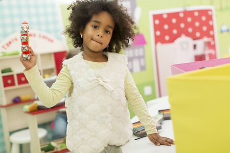 playroom: Little african girl at the playroom Stock Photo