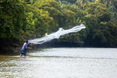 india fisherman: AGONDA, INDIA - OCTOBER 13, 2015: Unidnetified sea shore fisherman at Agonda beach, India. Agonda is a traditional fishing village.