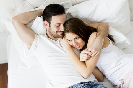 love couple: Young loving couple in the bed