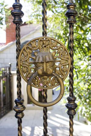 knocker: Door knocker on the gate