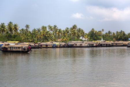 alleppey: KERALA, INDIA - OCTOBER 16, 2015: Boats at backwaters in Kerala, India. The backwaters are an extensive network of 41 west flowing interlocking rivers, lakes and canals that center around Alleppey, Kumarakom and Punnamada. Editorial