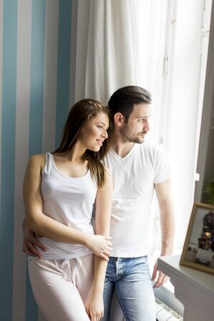 Loving couple by the window
