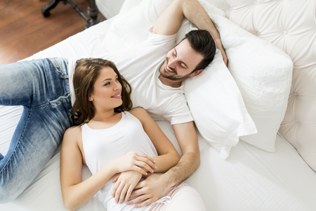 Young loving couple in the bed