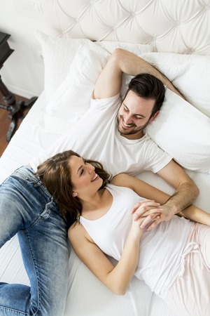 Young loving couple in the bed Stock Photo