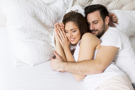 Loving couple in the bed Stock Photo