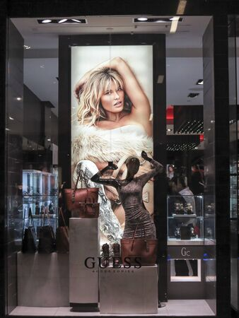 guess: ALBERTA, CANADA - SEPTEMBER 23, 2014: Guess shop in Alberta, Canada. Guess is an American upscale clothing line brand that also markets other fashion accessories such as watches, jewelry and perfumes.