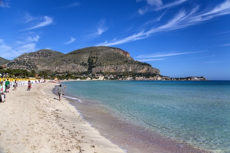 mondello: MONDELLO, ITALY - MAY 1, 2014: Unidentified people at the beach of Mondello at Sicily.  At the end of the 19th century Mondello grew into a favourite tourist destination