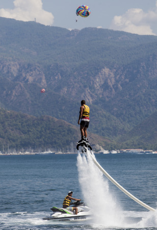 watercraft: MARMARIS, TURKEY - SEPTEMBER 17, 2014: Unidentified man on flyboard at Marmaris, Turkey. Flyboard was invented in spring 2011 by a French watercraft rider, Franky Zapata.
